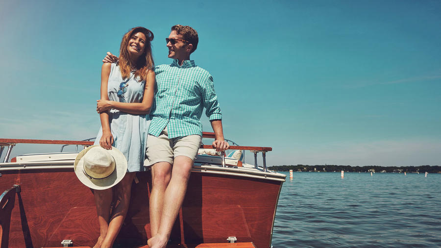 Man and a Woman Smiling on a Boat